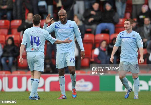 Coventry City's Stephen Elliott William Edjenguele and John Fleck celebrate victory during the npower League One match at Brisbane Road London