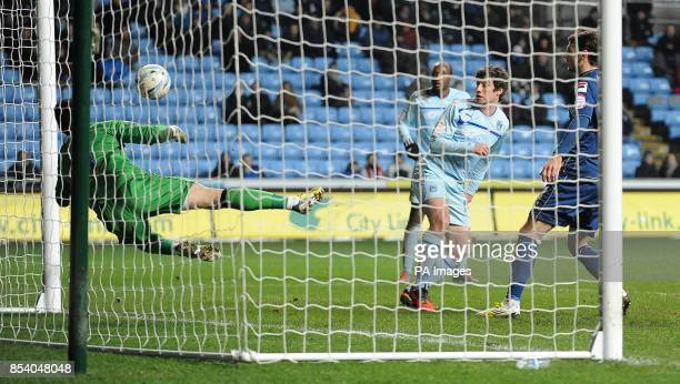 Coventry City's Stephen Elliott's header is saved by Oldham Athletic's Dean Bouzanis during the npower League One match at the Ricoh Arena Coventry