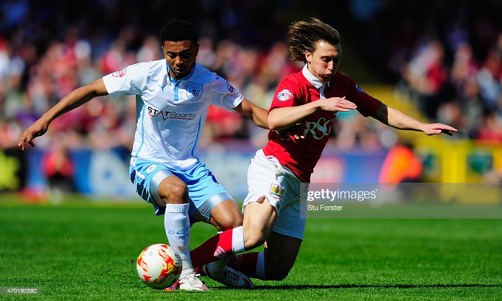 Coventry player Grant Ward challenges Luke Freeman of Bristol City during the Sky Bet League One match between Bristol City and Coventry City at...