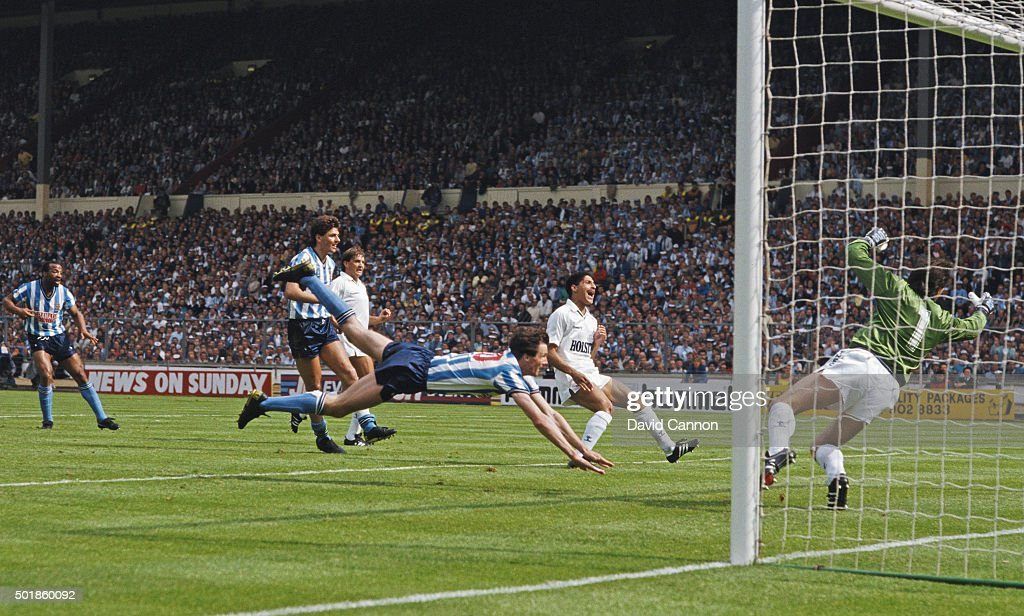 Coventry striker Keith Houchen dives to head the second goal past Spurs goalkeeper Ray Clemence as defender Chris Houghton reacts during the 1987 FA...