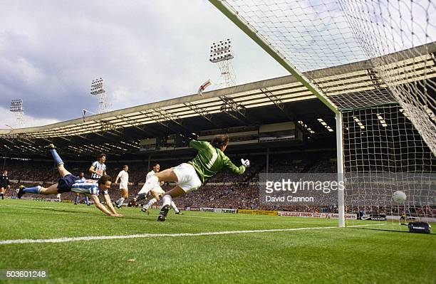Coventry striker Keith Houchen dives to score past Spurs goalkeeper Ray Clemence during the 1987 FA Cup Final between Coventry City and Tottenham...