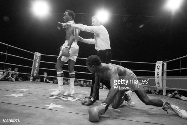 Coventry's Errol Christie on his hands and knees after a knock down as referee Mike Jacobs ushers American Charlie Boston to the neutral corner after...