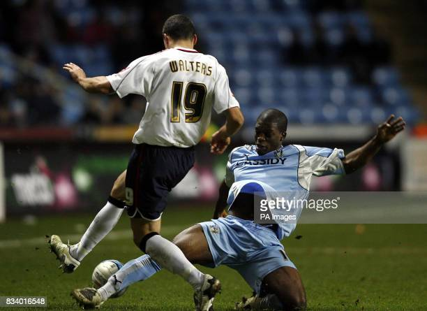 Coventry's Isaac Osbourne challenges Ipswich's Jon Walters during the CocaCola League Championship match at The Ricoh Arena Coventry
