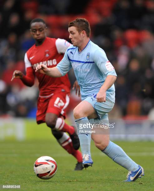 Coventry's John Fleck in action with Leyton Orient's Moses Odubajo during the npower League One match at Brisbane Road London