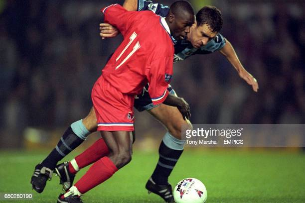 Coventry's Liam Daish chases Dennis Bailey of Gillingham