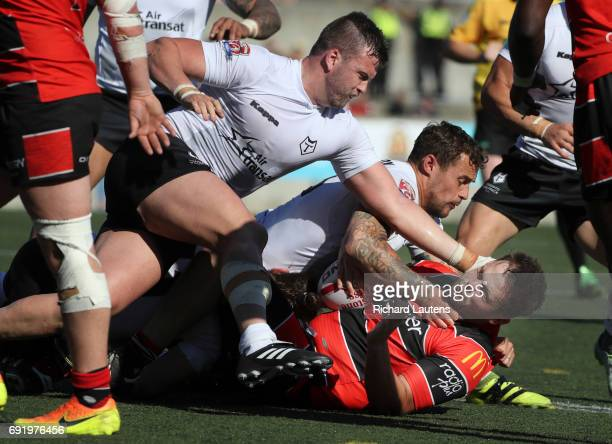 TORONTO ON JUNE 3 Coventry's Paddy Jones gets swarmed by Toronto players and goes down hard Canada's first professional rugby team the Toronto...