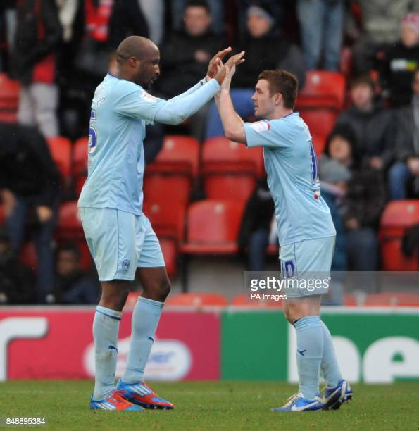 Coventry's William Edjenguele and John Fleck celebrate their victory during the npower League One match at Brisbane Road London