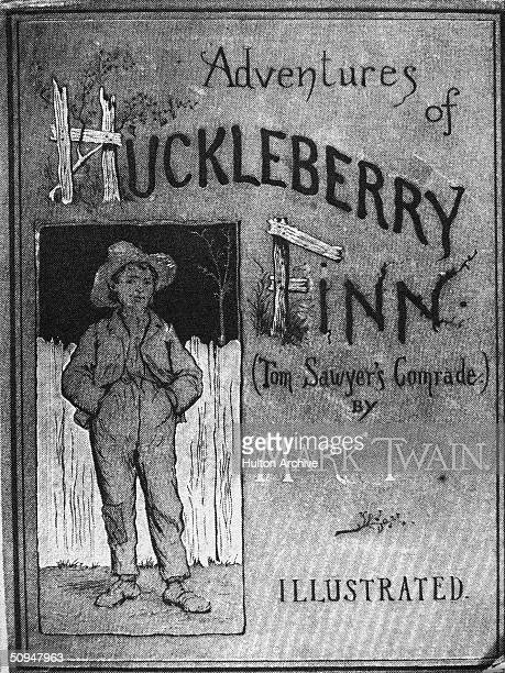 Cover of the book 'Adventures of Huckleberry Finn ' by Mark Twain 1884 The illustration by E M Kimble shows a young boy who stands in front of a...