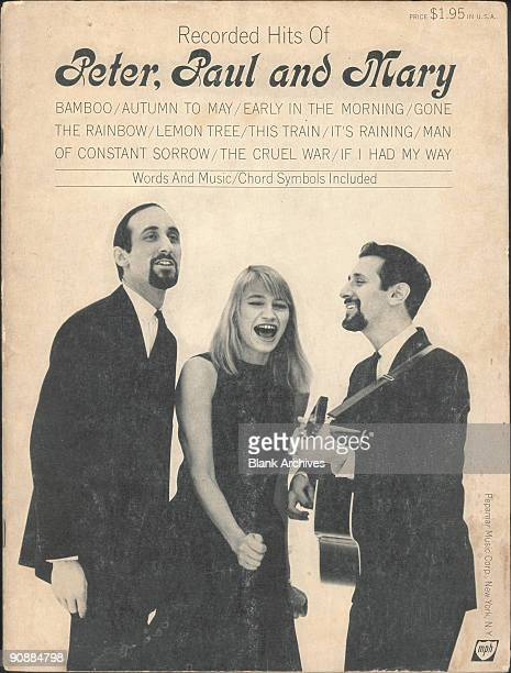 Cover of the 'Recorded Hits Of Peter Paul and Mary' song book 1962 The cover features a photo of the trio as they sing from left Paul Stookey Mary...