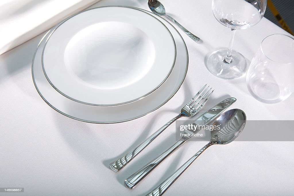 cover on a table. nice looking plates and  cutlery : Stock Photo