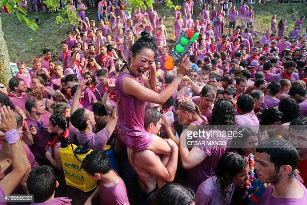 Covered in wine revellers enjoy during the'Batalla del Vino' in Haro on June 29 2015 Every year thousands of locals and tourists climb a mountain in...