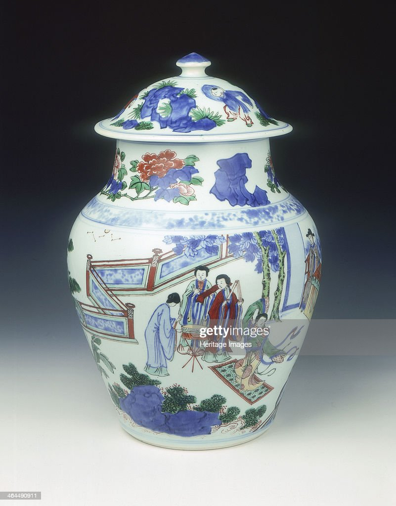 A covered jar with globular body decorated with a design of a garden scene with ladies dancing The scene is bordered above by a band of wetdrawn...