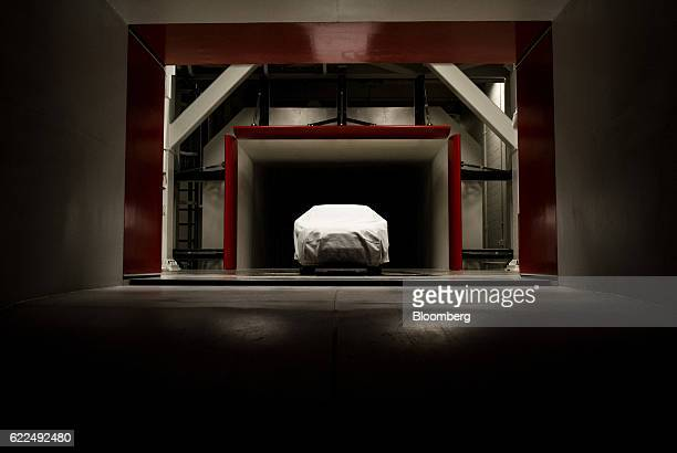 A covered scale model of a Honda Motor Co vehicle sits in the wind tunnel ahead of a aerodynamics test at the Honda Research and Development Americas...