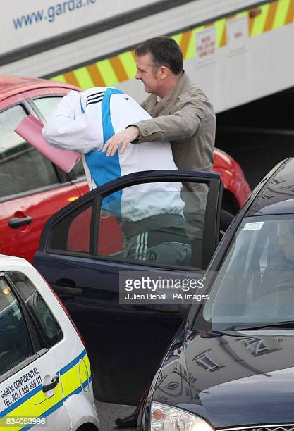 A covered up Anthony Dowling from Forklawn Drive Blanchardstown west Dublin leaves Dublin District Court where he was bailed to return next week...
