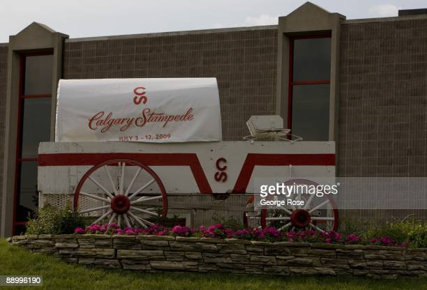 A covered wagon greets visitors at the entrance to the Calgary Stampede as seen in this 2009 Calgary Canada morning city landscape photo