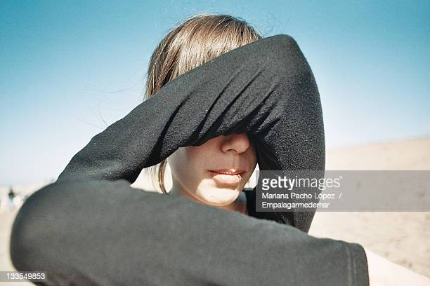 Covering his face young