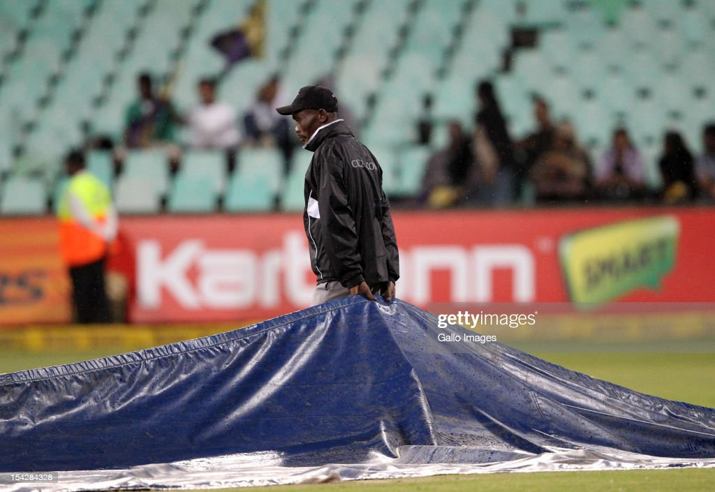Covers are laid on the pitch after rain stopped play during the Karbonn Smart CLT20 match between Kolkata Knight Riders and Perth Scorchers at Sahara Stadium Kingsmead on October 17, 2012 in Durban, South Africa.