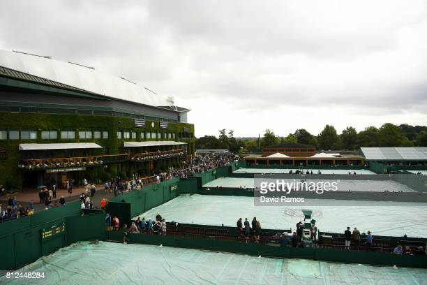 Covers are seen on outside courts as rain stops play on day eight of the Wimbledon Lawn Tennis Championships at the All England Lawn Tennis and...