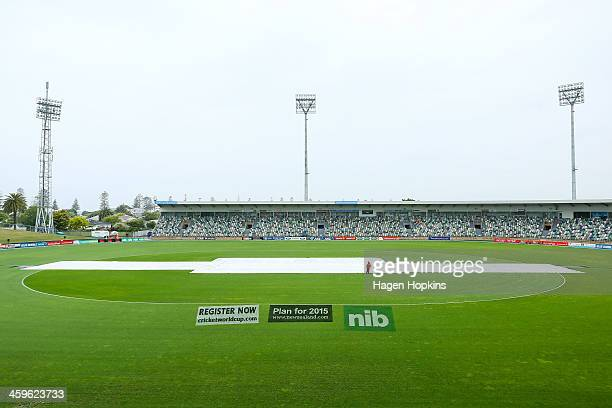 Covers protect the wicket during a rain delay prior to game two of the One Day International series between New Zealand and the West Indies at McLean...