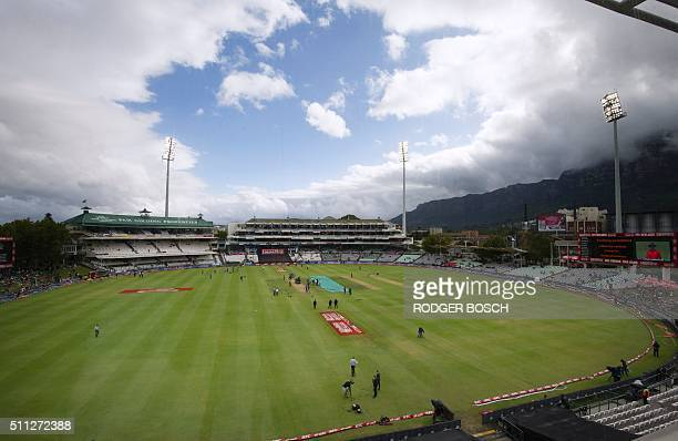 Covers remain on the pitch as the clouds and rain begin to clear before the first of two T20 matches between South Africa and England at Newlands in...