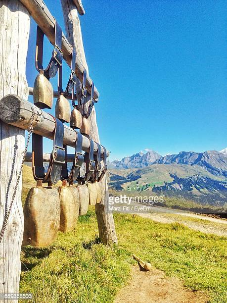 Cow Bells Displayed For Sale By Against Mountains