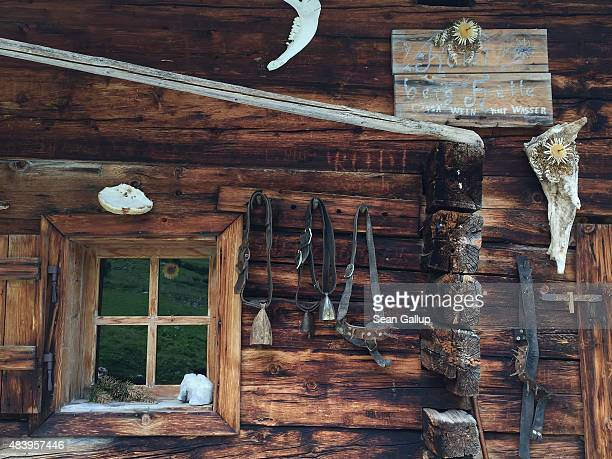Cowbells hang on the outside wall of an alpine hut called an alm used by cattle herders in the Karwendel mountain range on August 8 2015 near...