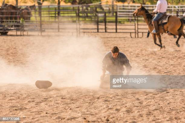 Cowboy After Falling From a Bucking Bronco at a Rodeo