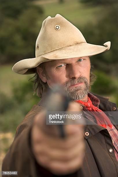 Cowboy aiming pistol