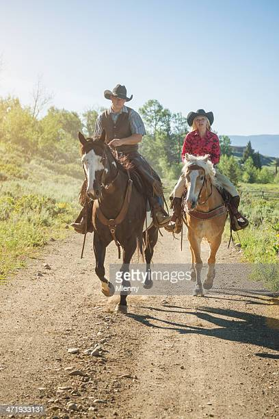 Cowboy and Cowgirl Horseback Riding