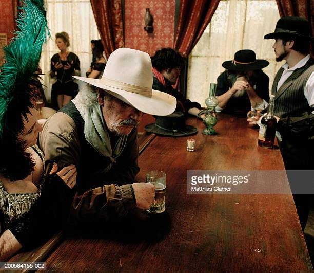 Cowboy at bar counter in saloon