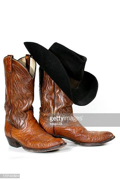 Cowboy boots and hat on white background