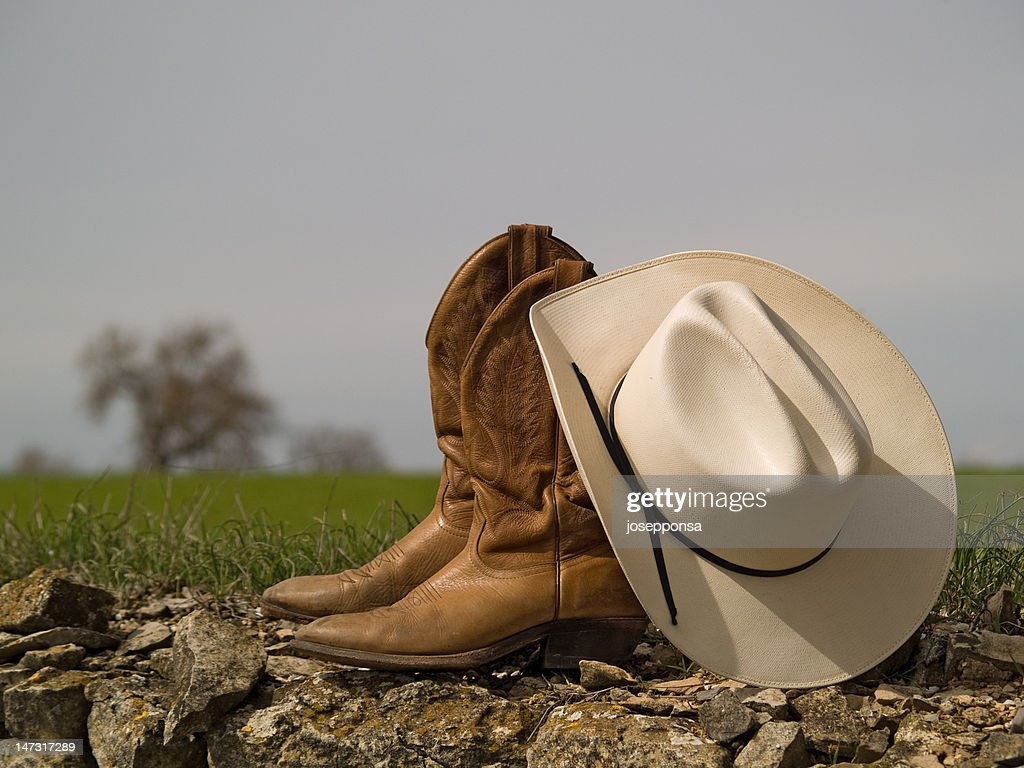 Cowboy boots&hat and tree : Stock Photo