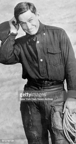 Cowboy comic Will Rogers poses for the camera