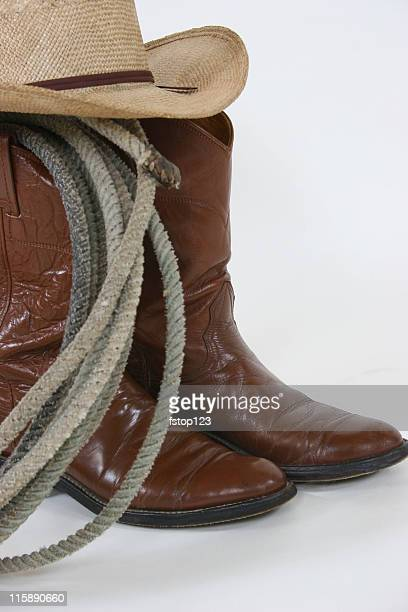 Cowboy gear boots, hat and rope