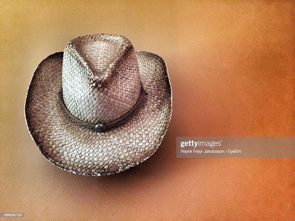 Cowboy Hat Hanging On Wall At Home