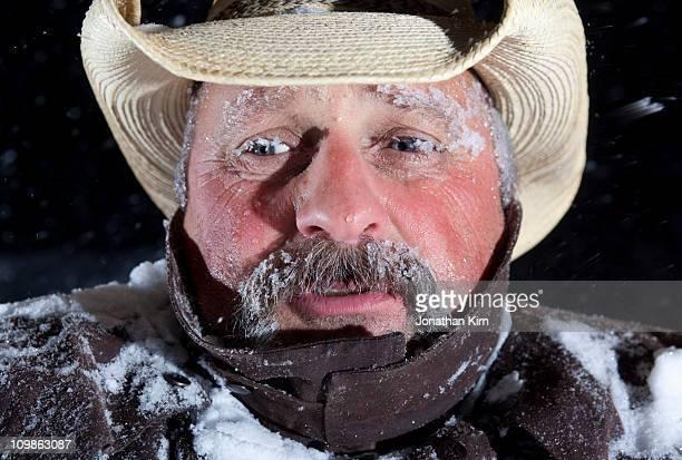 Cowboy in blizzard.