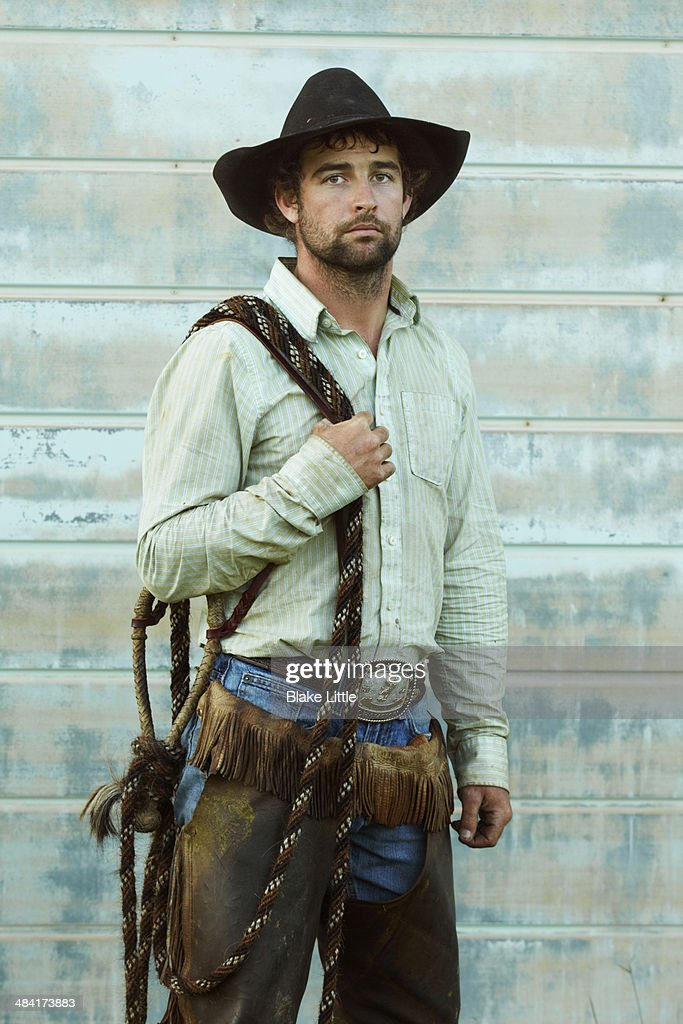 Cowboy in front of the green wall : Stock Photo