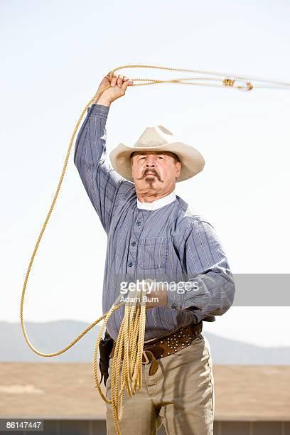 A cowboy lassoing
