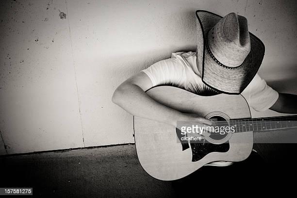 Cowboy spielt Gitarre
