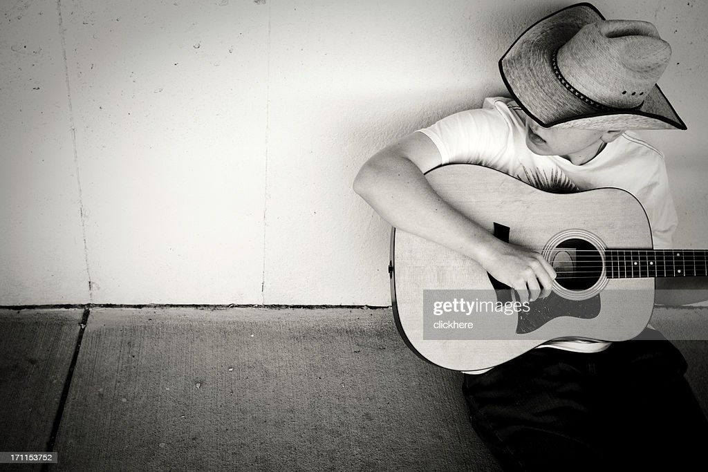 Cowboy Playing Guitar with copy space : Stock Photo