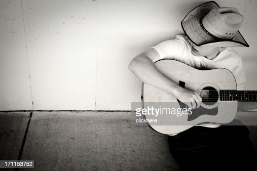 Cowboy Playing Guitar with copy space