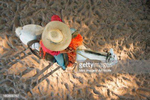 A cowboy riding a horse, Fazenda Rio Negro, Pantanal, Brazil : Stock Photo