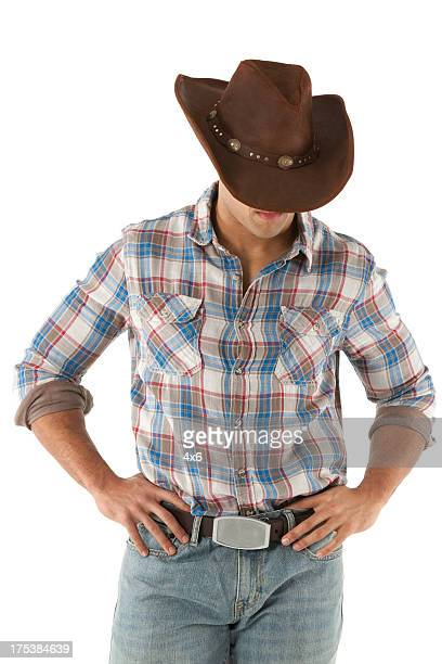 Cowboy standing with arms akimbo