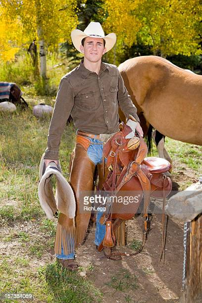 Cowboy Standing with his Saddle