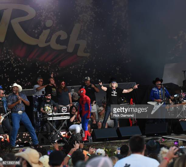 Cowboy Troy and Spider Man joins Big Kenny and John Rich of Big and Rich onstage during Country Thunder Day 4 on July 23 2017 in Twin Lakes Wisconsin