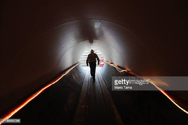 A cowboy walks through a tunnel beneath the track at the Calgary Stampede on July 11 2011 in Calgary Alberta Canada The ten day event drawing over...