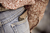 Wallet in a cowboys back pocket.