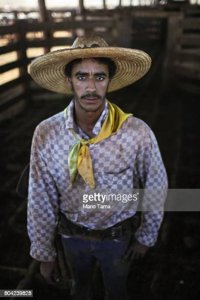 Cowboy Wellington poses at a cattle feed lot in the Amazon on June 28 2017 near Chupinguaia Rondonia state Brazil The confinement farm currently...