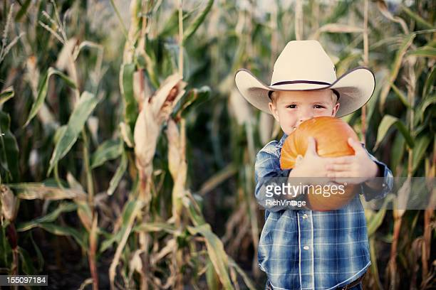 Cowboy with Fall Pumpkins