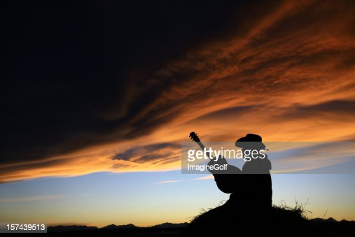 Cowboy with Guitar Silhouette